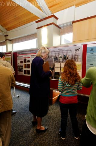 Judge reviews student poster presentation