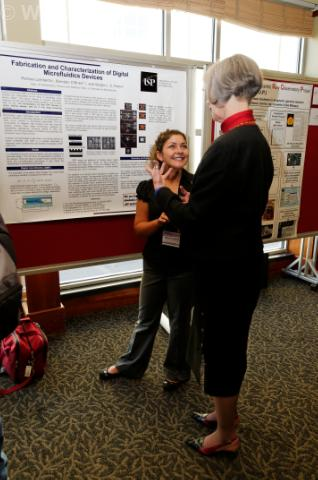 Student discusses poster presentation